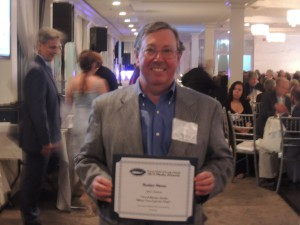 Editor in Chief John Owens with his Third Place Award for Narrative: Editorial Commentary for The Roslyn News. (Photo by Dave Gil de Rubio)