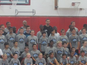 Danny Green (center) posing with a group of campers at on of his past basketball clinics.