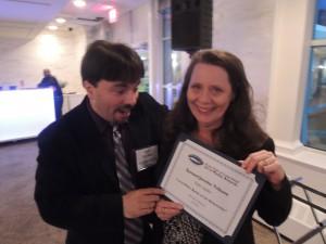 ong Island Weekly & Garden City Life Editor Dave Gil de Rubio congratulates Managing Editor Edith Updike. (Photo by John Owens)