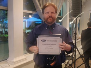 Cartoonist Matt Bodkin after sweeping the Visual Cartoon category. This is the Second Place Award he won for the Massapequa Observer. (Photo by Dave Gil de Rubio)