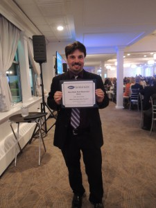 Long Island Weekly & Garden City Life Editor Dave Gil de Rubio with his Third Place Award for Narrative: Education. (Photo by John Owens)