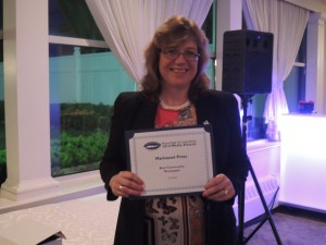 Manhasset Press Editor Elizabeth Johnson posing with her Second Place award for Best Community Newspaper (Photo by Dave Gil de Rubio)