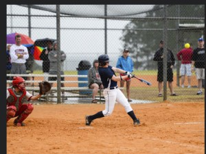 Samantha Trapasso swatting one of the record-setting 18 career homeruns she hit while attending SUNY Geneseo.