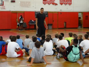 Danny Green speaking with young charges at his Floral Park Memorial High School basketball camp