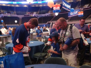 Defenseman Calvin de Haan was one of the many younger players out signing autographs for fans during the draft party. (Photo by Aaron Cheris)