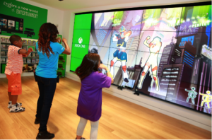 Customers testing out some of the wares at the new Microsoft store that calls Roosevelt Field Mall home.