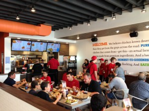 Pudgie's Naked Chicken Co. recently relaunched to a packed house in its newly-opened Massapequa flagship store.