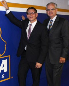 New Hofstra head coach Dennis Papadatos with Hofstra Athletic Director Jeffrey Hathaway in the Hofstra wrestling room.