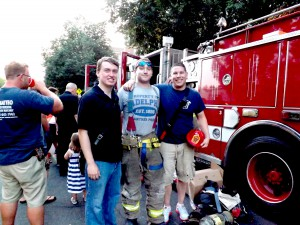 Garden City firefighters Steve Hartstein (center) and James Taunton (right) enjoying the promenade (Photo by Amanda Mullen)