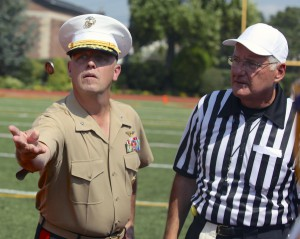 Brig. Gen. Kevin Kilea of the Class of 1983 participating in the coin-toss before the game