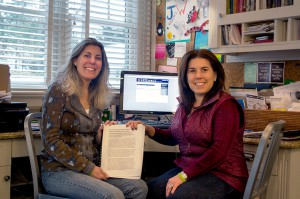 Deborah Abramson Brooks (l.) and Allison White with their petition to stop inBloom. With all of the signatures and comments, the document runs nearly 500 pages.