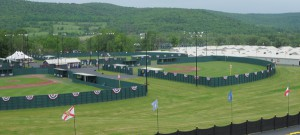 A Long Island little league coach is being charged with allegedly pocketing $12,000 players raised for a trip to Cooperstown.