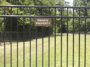Franklin Court Mews, LLC, purchased surplus green space from the Village of Garden City and fenced-off what had previously been open to local residents