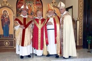 From left: Bishop John Herzog, Fr. Christopher Bauman, Bishop Andrew Bixler and Bishop Peter Robert Raimondi.