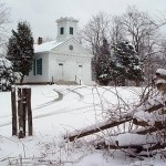 A snow-covered Old Bethpage Village Restoration