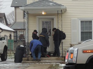 Police are investigating a Mineola shooting outside this Roslyn Road home. (Photo by Rich Forestano)
