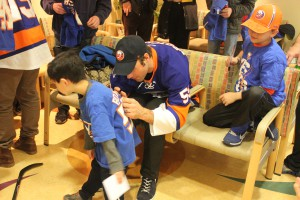 Defenseman Johnny Boychuck signs autographs at the Cancer Center for Kids.