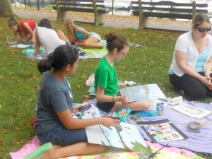 Painting on the lawn at Summer Art Adventure camp.