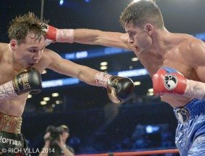 Chris Algieri (right) going to work on Ruslan Provodnikov during Algieri's June 2014 upset at Barclays Center (Photo by Rich Villa)