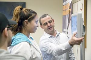 An Adelphi University student received details during a concussion management program demonstration.