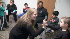 A Life's WORC staffer interacts with some of the many special needs children that end up frequenting the center.