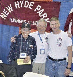 New Hyde Park Road Runners George Erkmann and Greg Nold, with NHPRC member on left