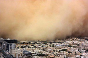 Tons of sediment wash over a city in Saudi Arabia during a recent sand storm.