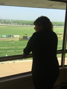 """Virginia """"Jenny"""" Kellner looks out over the track at Belmont Park from the Press Box. (Photo by Christy Hinko)"""