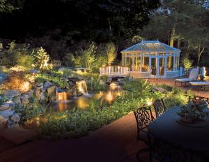 pond and pool pergola lit up
