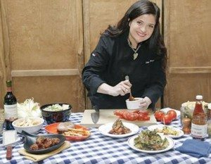 Chef and restaurant owner Alex Guarnaschelli is ready for summer with her wine and BBQ inspired menu. (Photo by Brian Ach/Getty Images)