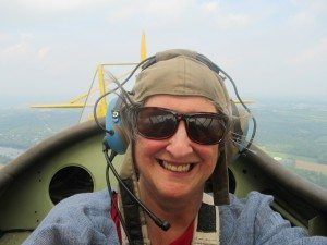 Lyn Dobrin in a biplane