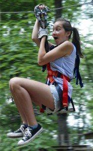 Zipline through the treetops at The Adventure Park.