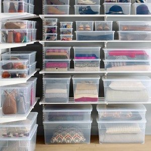 Clear storage boxes help keep a closet organized.