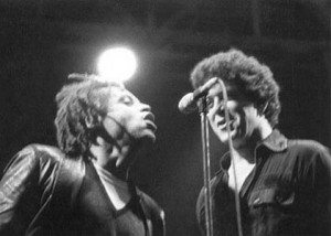 Garland Jeffreys and old friend and fellow Syracuse University alum Lou Reed sharing a mic onstage circa 1981