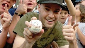 Zack Hample clutching A-Rod's 3,000th hit at Yankee Stadium right after catching it