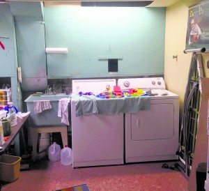 Before: This laundry room was messy and had little storage space.