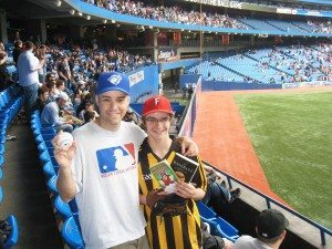 Zack Hample with a fan and his 5,000th ball that was caught at Rogers Center.