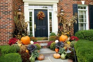 Think outside the box when it comes to decorating your patio. Add pumpkins, gourds, haybales and cornstalks in addition to chrysanthemums.