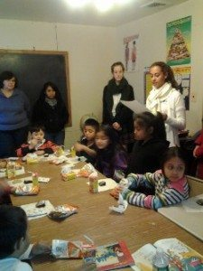 Our Lady of Mercy Academy Spanish Honor Society visiting children at Casa Mary Johana during the holidays.