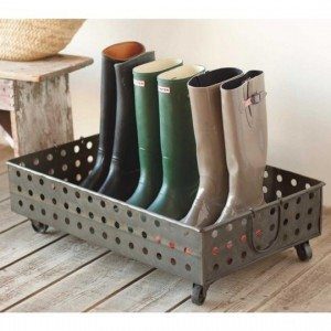 A boot tray also becomes an essential component of front hall closet storage.