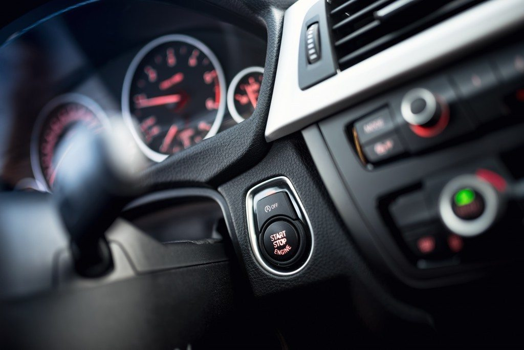 close-up of car start and stop button. Modern car interior with
