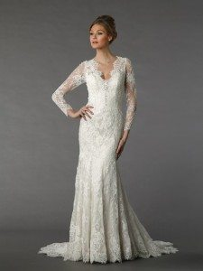 This long sleeve lace sheath dress by Danielle Caprese is perfect for a chilly autumn wedding. (Danielle Caprese for Kleinfeld)