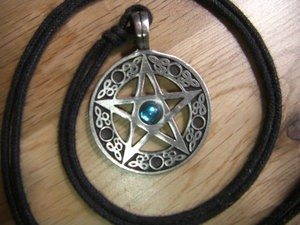 This pentacle, worn as a pendant, depicts a pentagram, or five-pointed star, used as a symbol of Wicca by many practitioners.