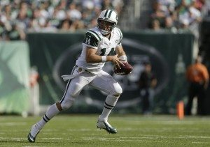 New York Jets quarterback Ryan Fitzpatrick (14) scrambles out of the pocket against the Philadelphia Eagles during the fourth quarter of an NFL football game, Sunday, Sept. 27, 2015, in East Rutherford, N.J. (AP Photo/Adam Hunger)