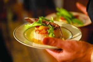 Scallops with an orange peel is a refreshing antipasto course.