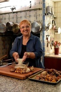 Lidia Bastianich prepares the rice and mushrooms for the risotto. (Photo by Lidia Celebrates America)