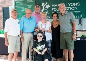 From left: Marty Lyons Foundation LI Chapter President Peter Michalewicz, Former Mayor Rudolph Giuliani, Marty Lyons, Diane Carroll, Sue Schroy and former New York Jet/foundation co-founder Ken Schroy. In front, wish child Shaun Carroll. (Photo courtesy of Rob Gulotta)
