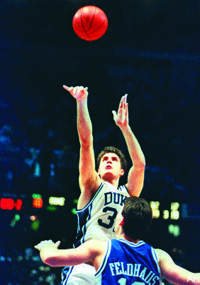 Duke's Christian Laettner putting the dagger in the heart of the Wildcats' hearts in the 1992 NCAA Finals.
