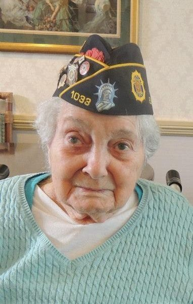 "Amelia ""Emily"" Tricoukes on May 5, 2013, at Sunrise of Plainview, while being visited by the women veterans of Post 1033."