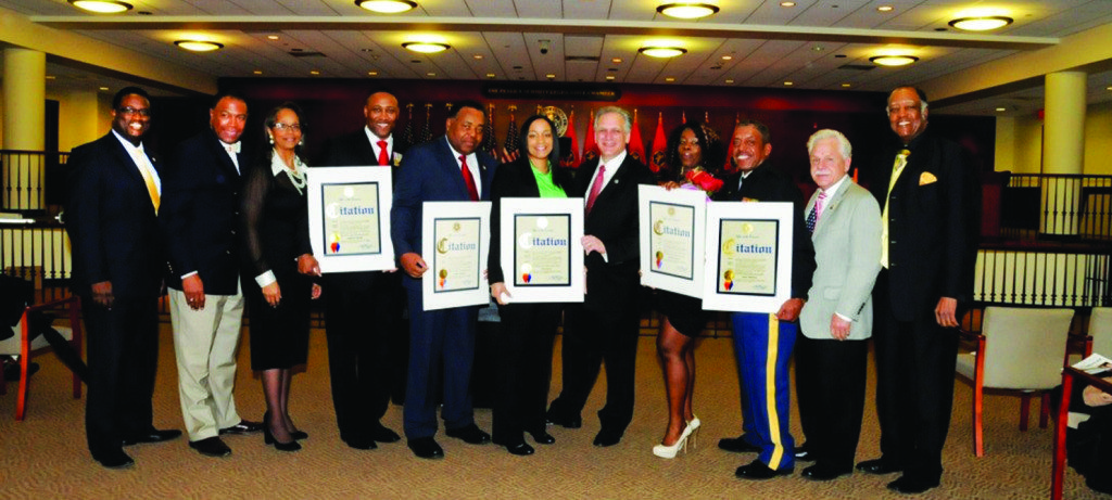 Pictured: Nassau County Human Rights Commissioner Rodney McRae; Nassau County Deputy County Executive for Minority Affairs Dr. Phillip Elliot; Acting Minority Affairs Executive Director Shelly Brazley; Thomas; Robbin; Davis; Mangano; Murray; Merritte; Nassau County Veteran Service Agency Director Ralph Esposito; and Rev. Dr. William Watson of the Long Island Conference of Clergy.